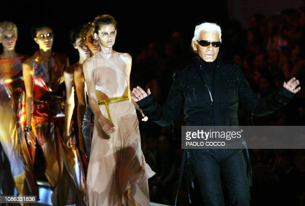 German designer Karl Lagerfeld walks ahead of British model Stella Tennant on the catwalk at the end of Fendi collection during Milan's 2004...