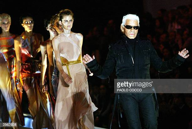 German designer Karl Lagerfeld walks on the catwalk at the end of Fendi collection during Milan's 2004 Spring/Summer fashion week 04 October 2003 The...