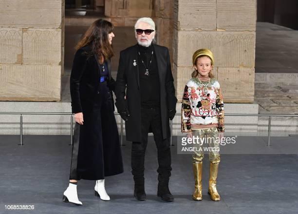 German designer Karl Lagerfeld walks the runway during the Chanel Metiers D'Art 2018/19 Show at The Metropolitan Museum of Art on December 4 2018 in...