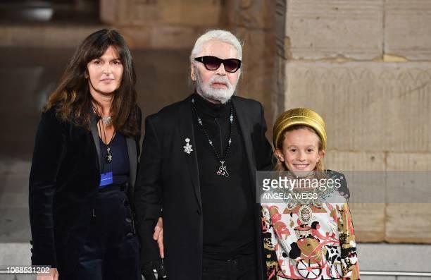 German designer Karl Lagerfeld walks the runway fashion studio director of Chanel Virginie Viard and his godson Hudson Kroenig during the Chanel...