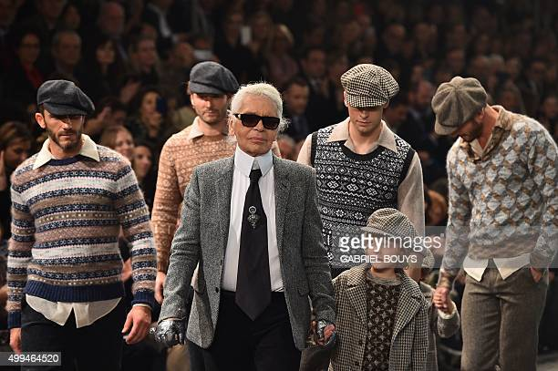 German designer Karl Lagerfeld walks the runway with his godson Hudson Kroenig at the end of the 12th Chanel Metiers dArt show ParisRome an annual...