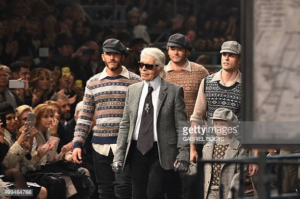 German designer Karl Lagerfeld walks the runway with models and his godson Hudson Kroenig at the end of the 12th Chanel Metiers dArt show ParisRome...