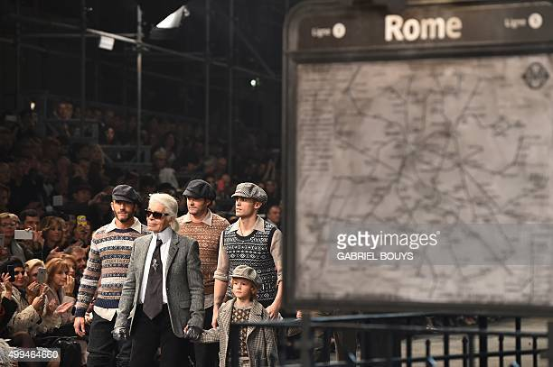 German designer Karl Lagerfeld walks the runway with models at the end of the 12th Chanel Metiers dArt show ParisRome an annual event to honor...