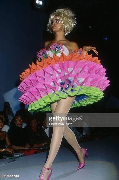 German designer Thierry Mugler shows his women's 1991 springsummer readytowear line in Paris Model Helena Christensen is wearing a layered...