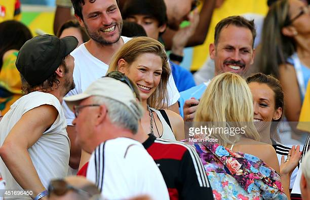 German designer Thomas Hayo and Lena Gercke girlfriend of Sami Khedira of Germany look on during the 2014 FIFA World Cup Brazil Quarter Final match...