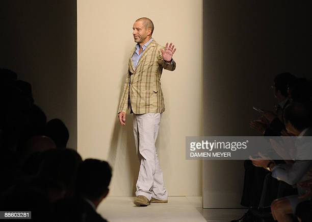 German designer Tomas Maier acknowledges the audience after the presentation of Bottega Veneta SpringSummer 2010 Menswear collection on June 21 2009...