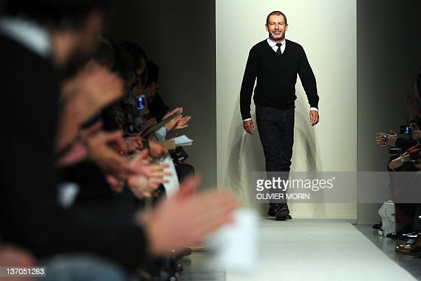 German designer Tomas Maier acknowledges the audience at the end of Bottega Veneta Fallwinter 20122013 Menswear collection on January 15 2012 during...