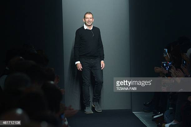 German designer Tomas Maier acknowledges the audience at the end of the Bottega Veneta collection show during the Fall/Winter 2015 Men's Fashion Week...