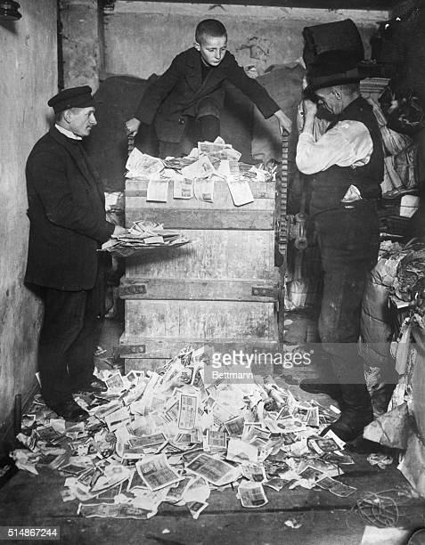 German deutsche marks worth much more as waste paper than the monetary value are being baled by workers in a Berlin second hand store