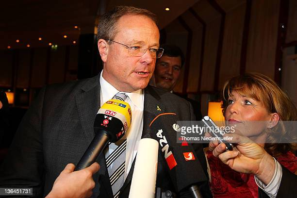 German Development Minister Dirk Niebel and his wife Andrea Niebel talks to the media at the FDP evening ball ahead of the Epiphany meeting of the...