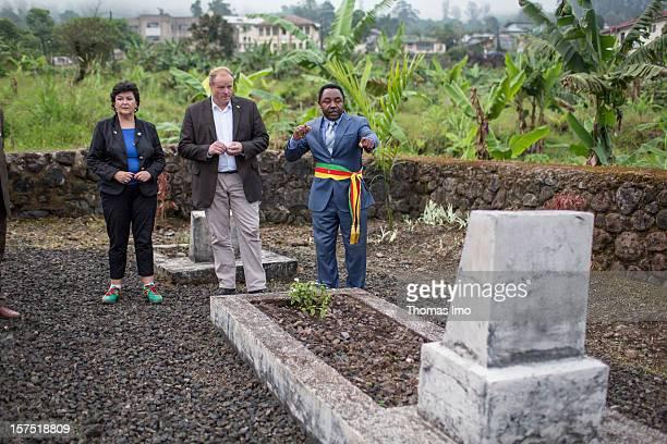 German Development Minister Dirk Niebel Free Democratic Party and Christiane RatjenDamerau MP are shown the grave of Johann Louis Arthur Biernatzky...