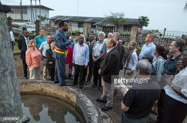 German Development Minister Dirk Niebel Free Democratic Party is shown the remains of German colonial buildings during a tour of the town by the...
