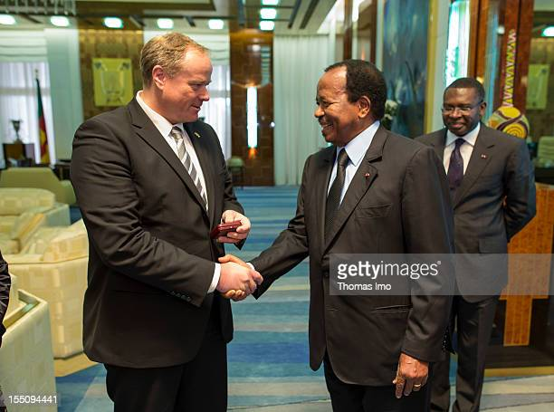 German Development Minister Dirk Niebel shakes hands with President of Cameroon Paul Biya on October 29 2012 in Yaounde Cameroon Niebel's visit to...
