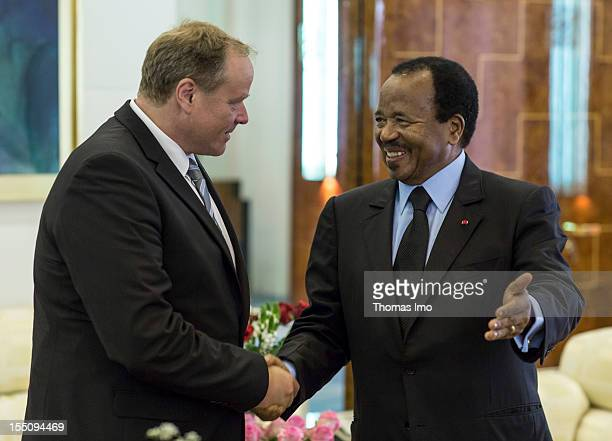 German Development Minister Dirk Niebel shakes hands with President of Cameroon Paul Biya on October 29 2012 in Yaounde Cameroon Niebel's visit will...