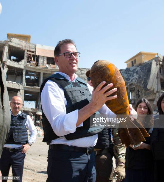 German Development Minister Gerd Mueller CSU holds a defused grenade in his hand He visits the UNMAS detonator removal at Al Shifaa Hospital in Mosul...