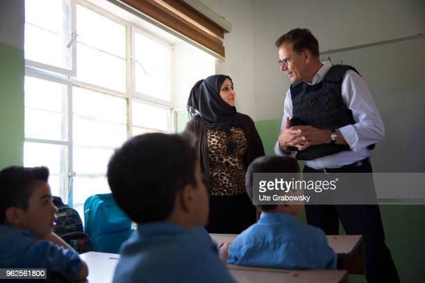German Development Minister Gerd Mueller CSU is visiting the Al Huda School of UNICEF a BMZfunded rehabilitation center in West Mosul on April 24...