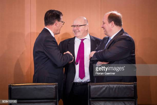 German Development Minister Gerd Mueller Head of the German Chancellery Peter Altmaier and Minister of State Helge Braun talk before the weekly...