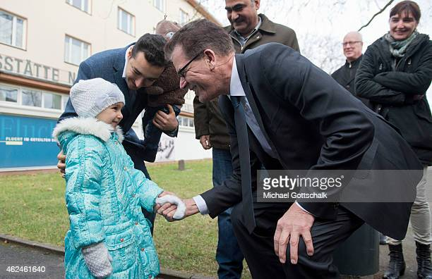 German Development Minister Gerd Mueller meets a young refugee from Syria during his visit to Refugees at Initial Reception Camp Marienfelde on...