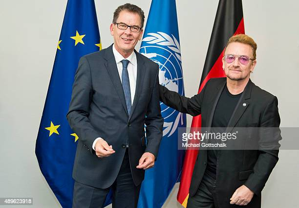 German Development Minister Gerd Mueller meets with Bono at the German Ministry of Development on September 23 2015 in Berlin Germany