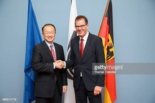 German Development Minister Gerd Mueller meets with World Bank Group President Jim Yong Kim on May 13 2014 in Berlin Germany
