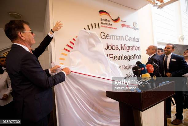 German Development Minister Gerd Mueller opens a migration advisory center with Iraqi Minister of Planning Ali Sindi in Baghdad Iraq 22 April 2018...