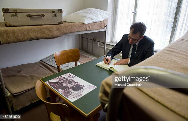 German Development Minister Gerd Mueller sits in a bedroom for refugees with interior from the 1960's in at memorial area during his visit to...