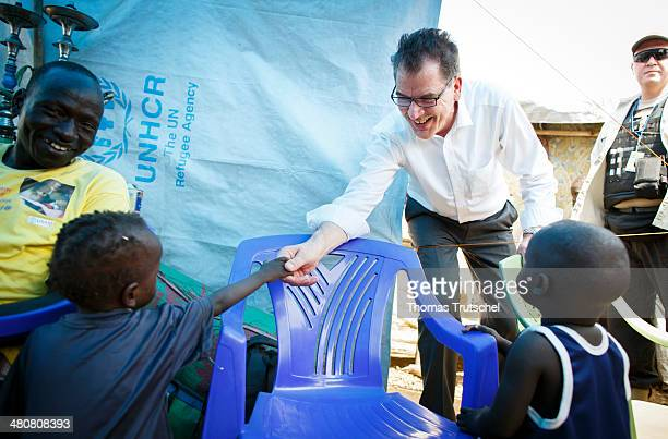 German Development Minister Gerd Mueller visits a refugee camp of United Nations Mission in the Republic of South Sudan on March 27 2014 in Juba...