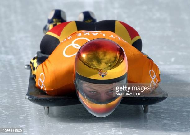 German Diana Sartor speeds through the ice channel during a training for the women's skeleton during the Salt Lake 2002 Olympic Winter Games at the...
