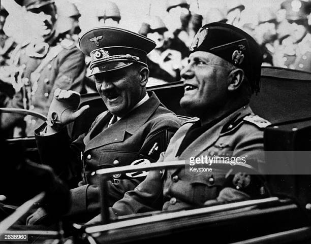 German dictator Adolf Hitler and his Italian counterpart Benito Mussolini share a joke during a drive in Florence