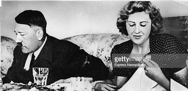 German dictator Adolf Hitler and his mistress Eva Braun dine in a still from a private home movie made by Braun's sister Gretl Fegelein early to mid...
