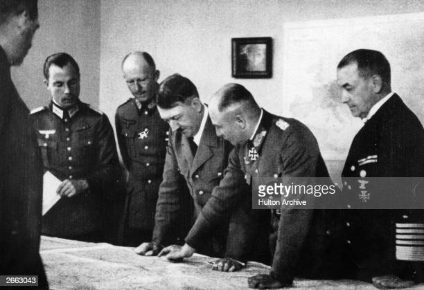 German dictator Adolf Hitler at his headquarters at BrulydePeche Ardennes Belgium during the campaign of MayJune 1940 Left of Hitler is General...