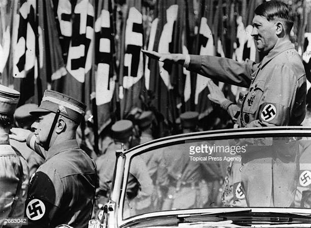 German dictator Adolf Hitler saluting at the giant Nazi parade at Nuremberg Original Publication People Disc HE0244