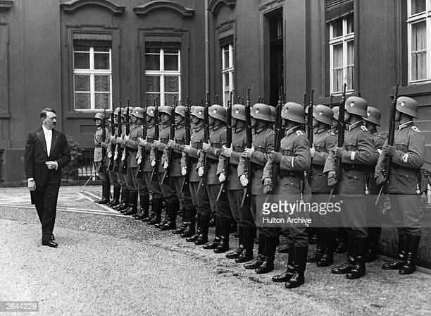 German dictator Adolf Hitler wearing evening dress inspecting the guard of honour after receiving the new Polish ambassador in Lipski