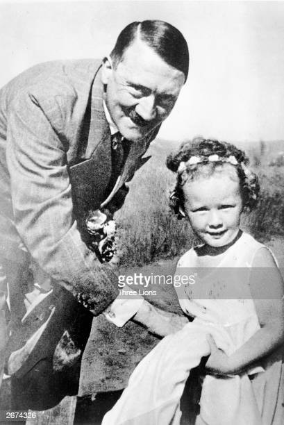 German dictator Adolf Hitler with a little girl