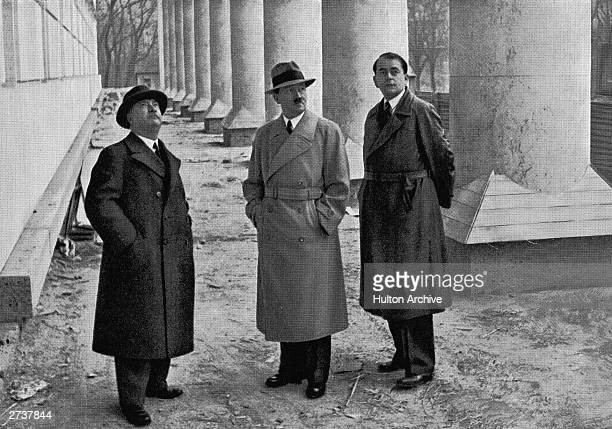 German dictator Adolph Hitler Architect Albert Speer and Professor Gall inspect the building of the Hause Der Deutschen Kunst in Munich Germany circa...