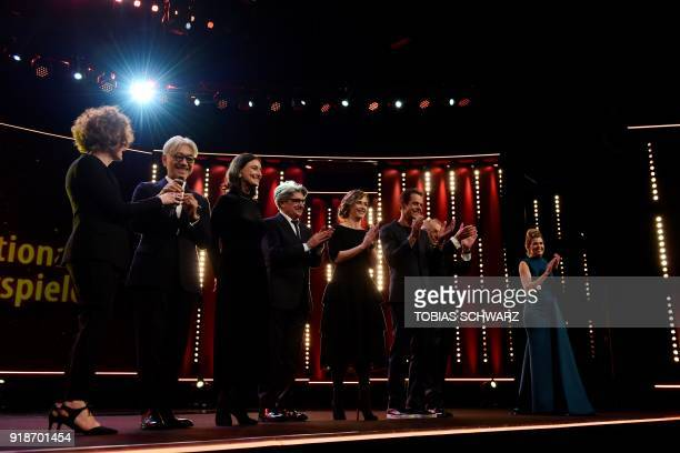 German director and president of the jury Tom Tykwer German TV host Anke Engelke stand on stage with jury members Belgian actress Cecile de France...