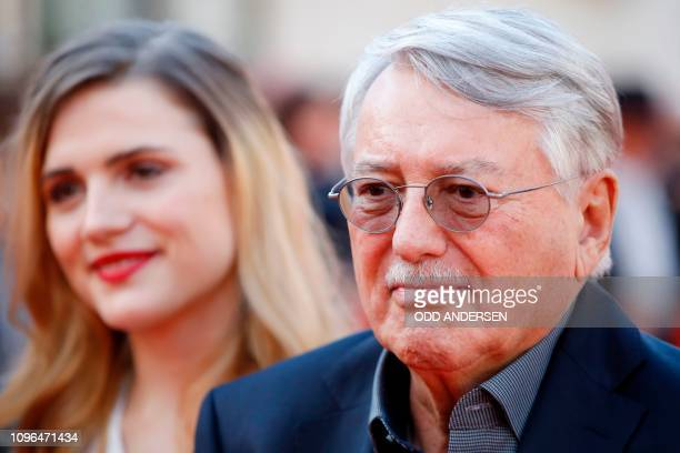 """German director and screenwriter Heinrich Breloer and German actress Mala Emde pose on the red carpet ahead of the premiere of the film """"Brecht"""" at..."""