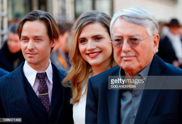 German director and screenwriter Heinrich Breloer , German actress Mala Emde and German actor Tom Schilling pose on the red carpet ahead of the...
