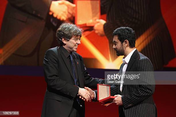 German director Andres Veiel receives the Alfred Bauer Award for 'Wer wenn nicht wir' from jury member Aamir Khan at the Award Ceremony during day...