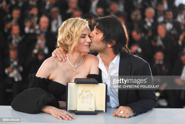 German director Fatih Akin kisses German actress Diane Kruger on May 28 2017 during a photocall after Kruger won the Best Actress Prize for Fatih's...