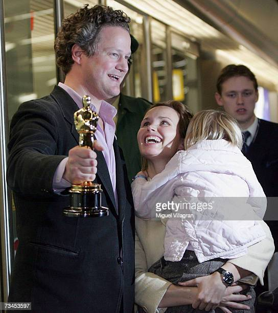 German director Florian Henckel von Donnersmarck poses with his Oscar Award for Best Foreign Language Film as he arrives with his wife Christiane...