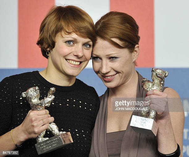 German director Maren Ade and Austrian actress Birgit Minichmayr pose with their respectively Jury Grand Prix silver bear and Silver bear for Best...