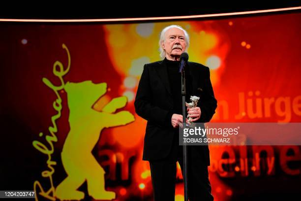 German director of photography Juergen Juerges delivers a speech after receiving Silver Bear for Outstanding Artistic Contribution during the...