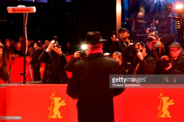 German director of the Berlinale Film Festival Dieter Kosslick poses for photographer on the red carpet before the awards ceremony of the 69th...