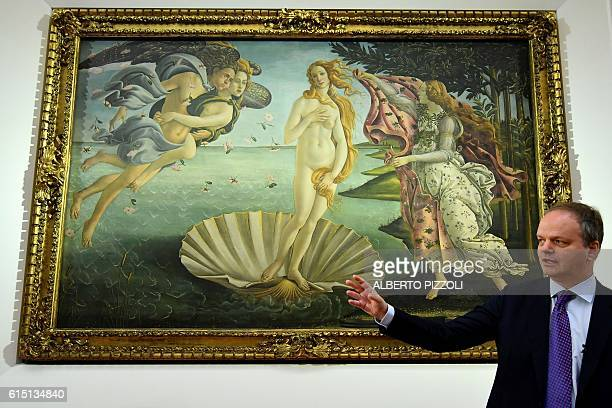 German director of the Uffzi Gallery Eike Schmidt gestures in front of the 'The Birth of Venus' painted in 1485 by Italian painter Sandro Botticelli...