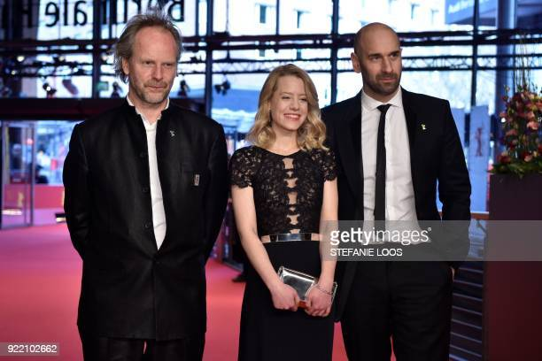 German director Philip Groening German actress Julia Zange and Swiss actor Urs Jucker pose on the red carpet before the premiere of the film 'My...