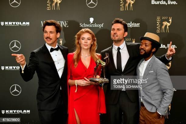 German director Simon Verhoeven actors Florian David Fitz and Eric Kabongo and RussianGerman actress Palina Rojinski pose after they received the...