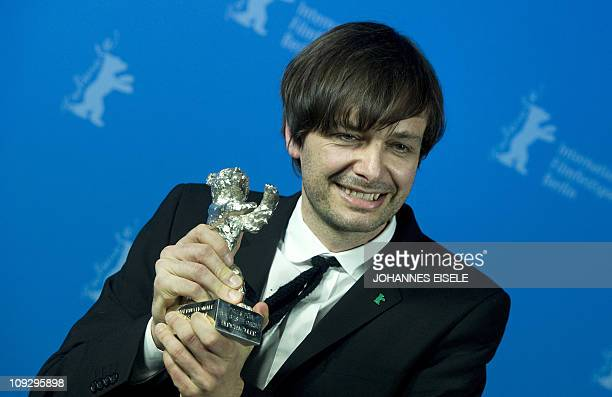 German director Ulrich Koehler poses with his silver bear for 'Best director' for his movie 'Sleeping Sickness' after the awards ceremony of the...