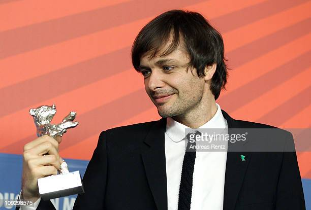 German director Ulrich Koehler poses with his silver bear for 'Best director' for his movie 'Sleeping Sickness' at the Award Winner press conference...