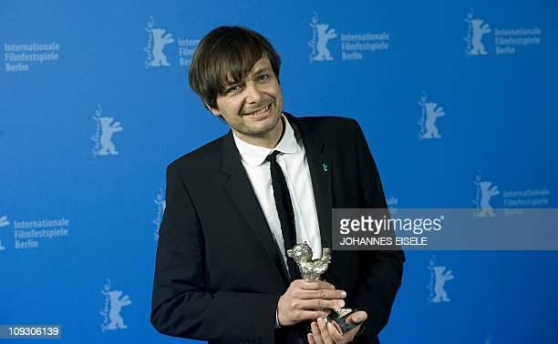 "German director Ulrich Koehler poses with his silver bear for ""Best director"" for his movie ""Sleeping Sickness"" after the awards ceremony of the..."
